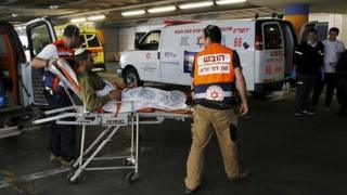 Israeli casualty being transported into hospital (04/12/15)