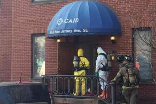 Hazardous materials teams entering CAIR HQ