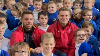Wales rugby players Rhys Webb and Dan Biggar with Ynysowen Primary pupils