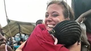 Katie Meyler hugs a child