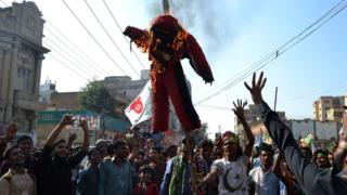 Protesters burning an effigy