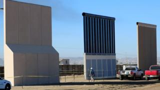 Three of Donald Trump's eight border wall prototypes are shown near completion along US- Mexico border in San Diego, California, October 23, 2017