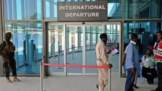 A member of the security services standing guard at the departures area of Mogadishu airport in Somalia - 11 February 2016