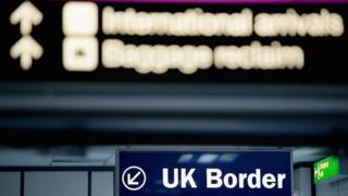Immigration and border control signs at Edinburgh Airport