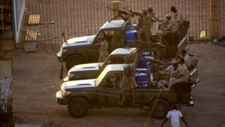 Sudanese army troops fire in the air