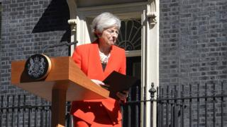 British Prime Minister Theresa May reacts at the end of her address to the media to announce her resignation