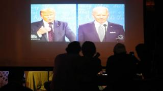 People in a Miami bar watch Donald Trump and Joe Biden join their first debate on the 2020 presidential campaign