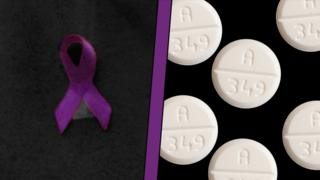 A purple ribbon and some pills