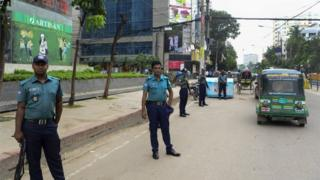 Bangladeshi police stand guard during a nationwide crackdown on militants, in Dhaka on June 13, 2016.