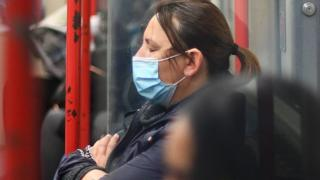 A woman on a train