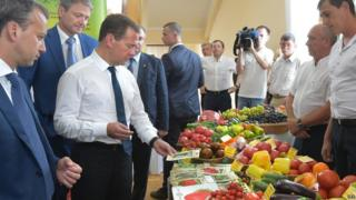 Russian Prime Minister Dmitry Medvedev inspects agricultural products grown in the Krasnodar region in the southern city of Krasnodar, Russia, 11 August 2015.