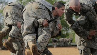 A female military officer takes part in a training exercise in the US