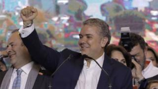 Newly elected Colombian president Ivan Duque celebrates with supporters in Bogota, after winning the presidential runoff election on June 17, 2018.