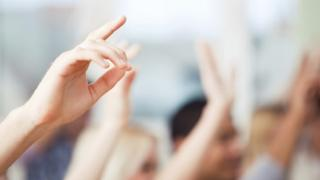Hands up in a classroom