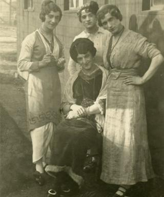Male internees dressed as women for a performance