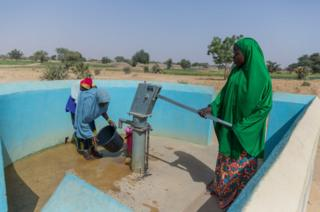 Women pump water