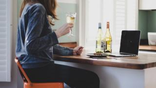 Woman drinking wine at home