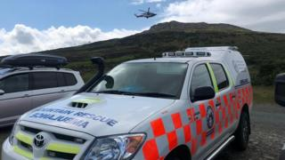 Mountain rescue vehicle and and Coastguard helicopter