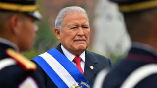 Salvadorean President Salvador Sánchez Cerén stands after delivering the annual address to the nation on his fourth year in office to the legislature in San Salvador on June 1, 2018.