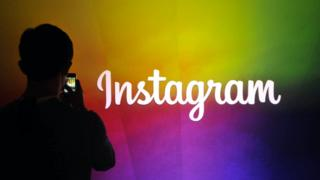 Man photographs Instagram logo