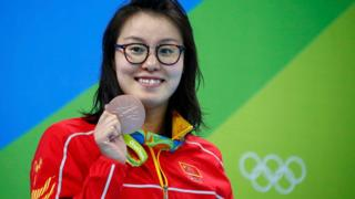 "Fu Yuanhui (CHN) of China (PRC) pose with her medal in the Women""s 100m Backstroke Victory Ceremony"