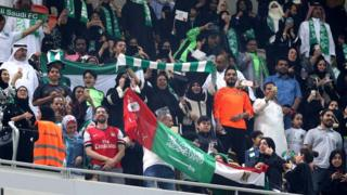 "Saudi families cheer at the King Abdullah Sports City known as ""a radiant jewel"" to attend the Saudi Football League soccer match Al Ahly and Al-Batin in Jeddah, Saudi Arabia, 12 January 2018."