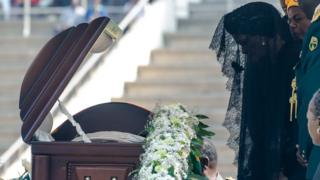 Zimbabwe's former First Lady Grace Mugabe says a final farewell at the casket of late Zimbabwean President Robert Mugabe on September 14, 2019 during a farewell ceremony held for family and heads of state at the National Sports Stadium in Harare. - Mugabe, who died in Singapore on September 6, 2019 at the age of 95, left Zimbabwe deeply divided over his legacy with his country still struggling with high inflation and shortages of goods after decades of crisis.