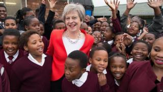 Theresa May meets students and staff at I.D. Mkize Secondary School in Cape Town, which is connected to Whitby High School in Yorkshire