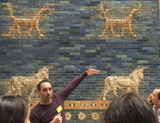 Bashar with Ishtar gate of Pergamon behind him