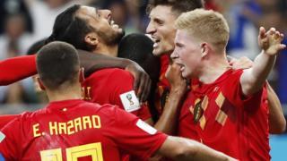 Belgium celebrate their winner against Japan