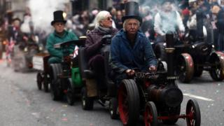 "People ride a traction engine during the New Year""s Day Parade in London,"