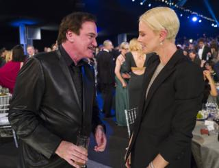 Quentin Tarantino and Charlize Theron