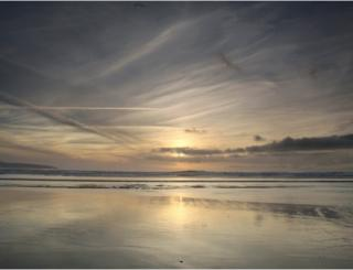 Sunset mirrored on a beach