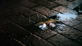 Poster in a puddle