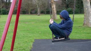 A sad child on a swing