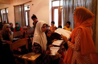 Kashmiris attending alternate classes in Srinagar.