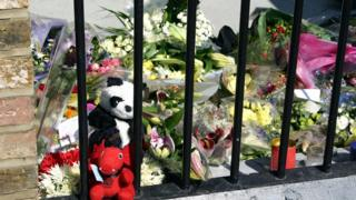 Flowers and letters of condolence are seen in the area outside Kings Cross Station set aside for floral tributes, 12/07/2005, following the London terror attack on 7th July 2005.