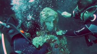 An underwater statue of the Virgin Mary