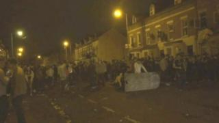 Trouble broke out as hundreds of students and other young people celebrated St Patrick's Day in Belfast's Holyland during the early hours of 17 March