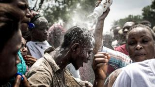 A supporter of Felix Tshisekedi being showered with power in Kinshasa, DR Congo - Thursday 10 January 2019