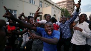 Men celebrate in Harare