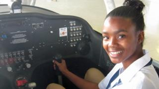 South African student Agnes Keamogetswe Seemela, 15, sitting in a plane