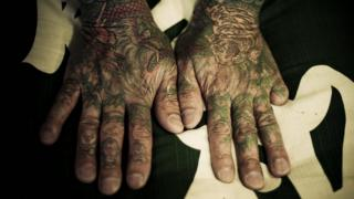 Hands with tattoos on them