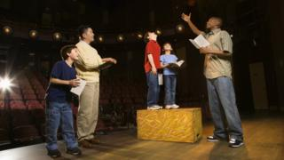 Children and actors in a play