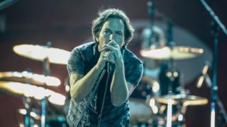 This file photo taken on September 26, 2015 shows Eddie Vedder of Pearl Jam performing