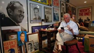 Roger Stone in his office filled with Nixon memorabilia