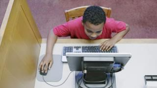 Boy on a library computer