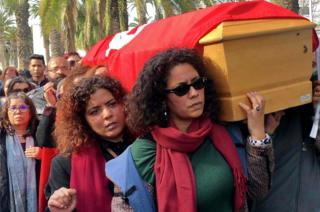 Tunisian women carry the coffin of human rights defender, internet-activist and blogger Lina Ben Mhenni during her funeral procession on January 28, 2020