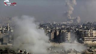 Screen grab from video provided by the Aleppo News Network shows smoke rising following an air strike that hit insurgents positions in eastern neighbourhoods of Aleppo, Syria, on 9 December 2016.