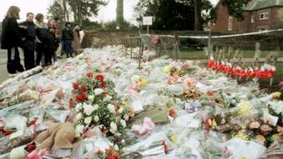 Flowers outside Dunblane Primary School a day after the shooting in 1996